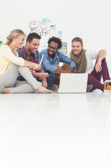 Team of creative designers sat on the floor