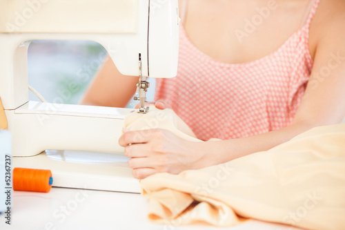 Fashion designer using a sewing machine