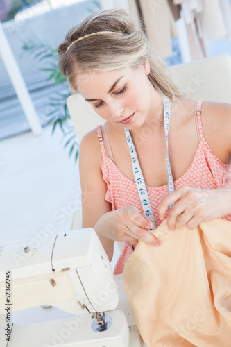 Fashion designer about to sew a textile