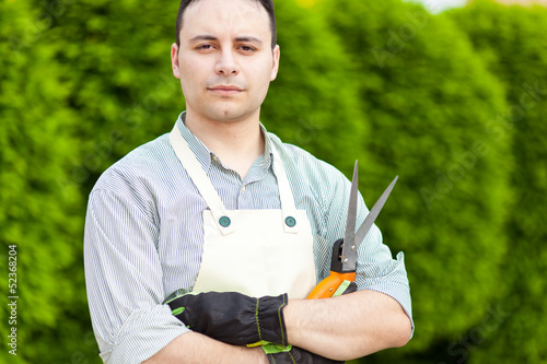 Handsome young gardener portrait