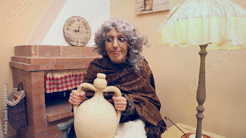 Grandma strange eagerly drinking from an earthenware jug