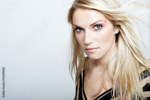 Beautiful blond woman looking at the camera