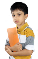 Depressed Indian School Boy with Textbook