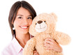 Cute woman with a teddy bear