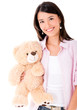 Woman holding a teddy bear