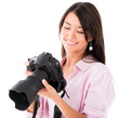 Woman looking at pictures on the camera