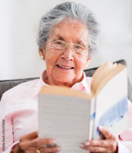 Retired woman reading a book