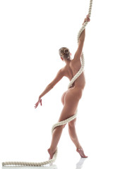 Image of flexible nude model posing with rope