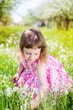 child girl at dandelion meadow in summer