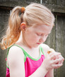 little girl with little chicken