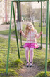 girl on swing in spring park