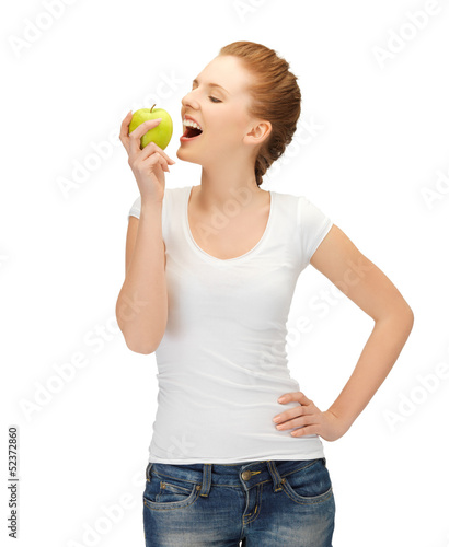 woman in blank t-shirt eating green apple