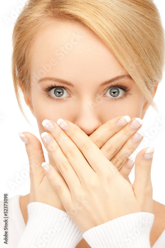 amazed woman with hand over mouth
