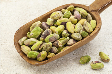 raw pistachio nuts on a scoop
