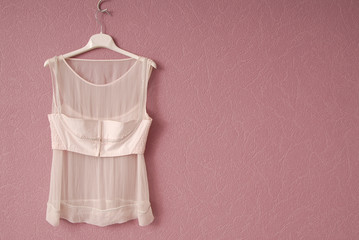 Transparent blouse is on lilac background.
