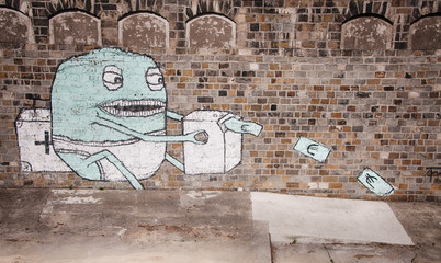 Graffiti in Vienna showing baby monster printing money
