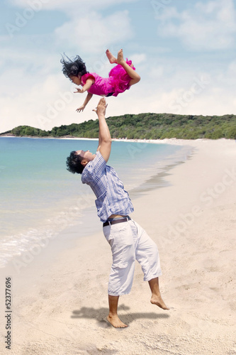 Father and daughter enjoy time at beach