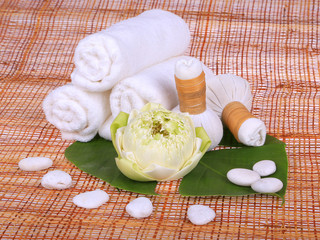 Spa massage setting with towel, thai herbal compress stamps and