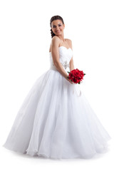 Pretty woman posing in wedding dress with bouquet