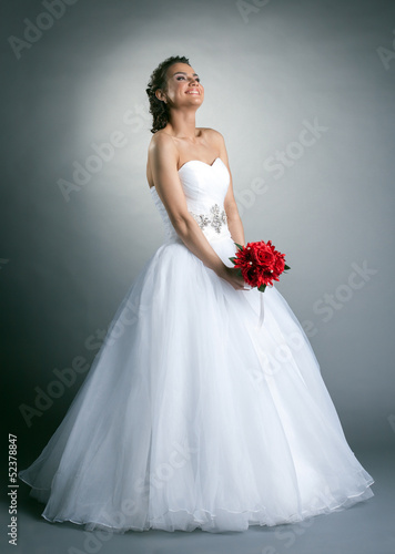 Beautiful slim bride posing in studio