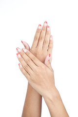female's hands with nice manicure isolated on white background