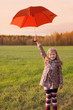 little girl with umbrella outdoor