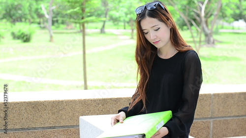 Asian women student looking profile in university and smiling
