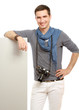portrait of a young photographer with a camera,