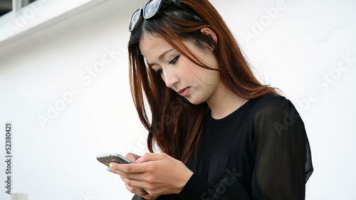 Close up beautiful young woman using a touch screen pad