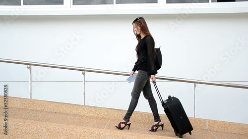 Young business woman on the phone and going to flight