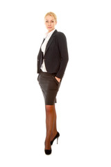 A full-length portrait of a beautiful businesswoman