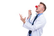 clown doctor singing karaoke on his stethoscope
