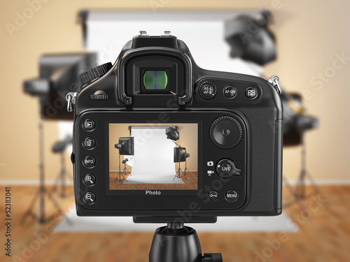Digital photo camera in studio with softbox and flashes. - 52383041
