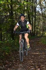 A mountain biker riding through a trail.
