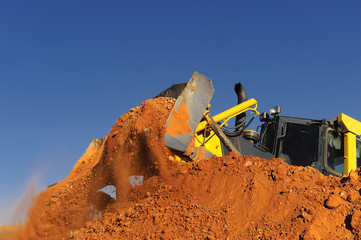 excavator working on blue esky