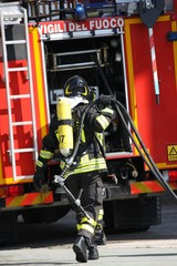 brave firefighters with oxygen tank fire during an exercise held