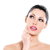Beautiful expressive woman cares of the skin face