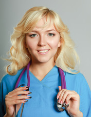 Closeup portrait of a female doctor with stethoscope