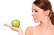 A portrait of beautiful young woman with a green apple
