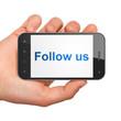 Social media concept: Follow us on smartphone