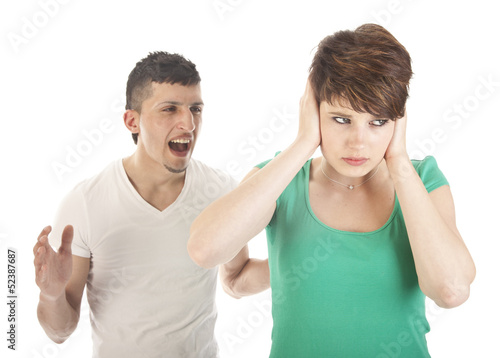 Young man and woman arguing isolated on white background