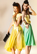 two beautiful girls dressed in summer dresses - studio shot