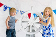 Cute sailor style kids holding steer wheel