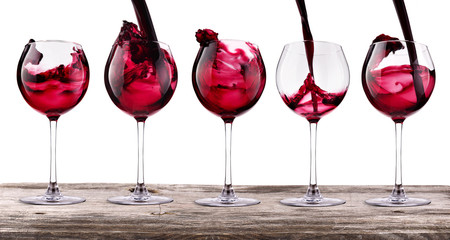 red wine set on a vintage wooden table