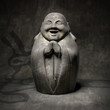 laughing buddha rocky sculpture