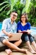 Asian prosperous couple in the garden