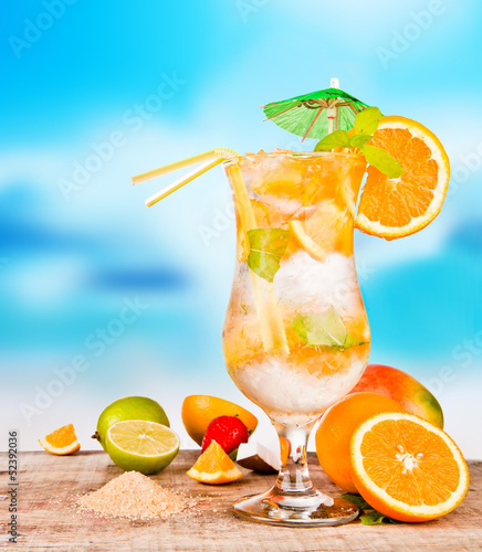 Summer drink with blur beach on background