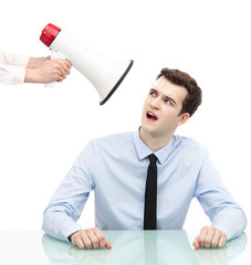 Businessman looking at megaphone