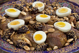 Moroccan meat, plums and eggs