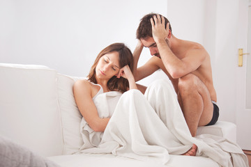 Young couple in the couch having conflict problem